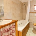 Natural stone tiled bathrooms some with jacuzzi baths